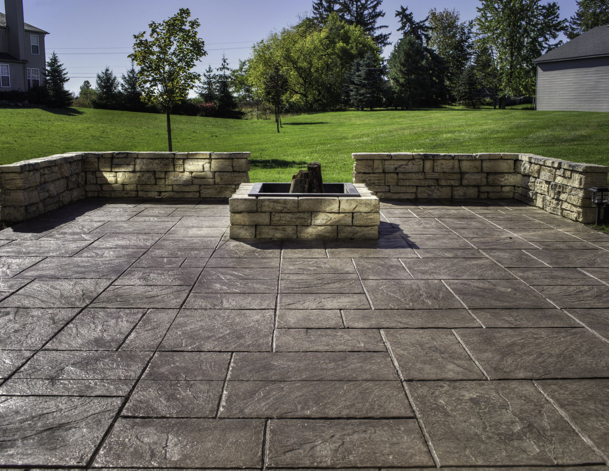 Delightful Spacious Outdoor Area Using Stamped Concrete Patio With Square Stone Fire  Pit Facing Grass Yard