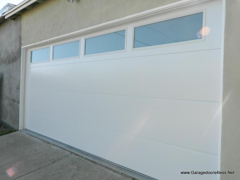 Garage doors 4 less flush panel garage studio makeover for Flush panel wood garage door