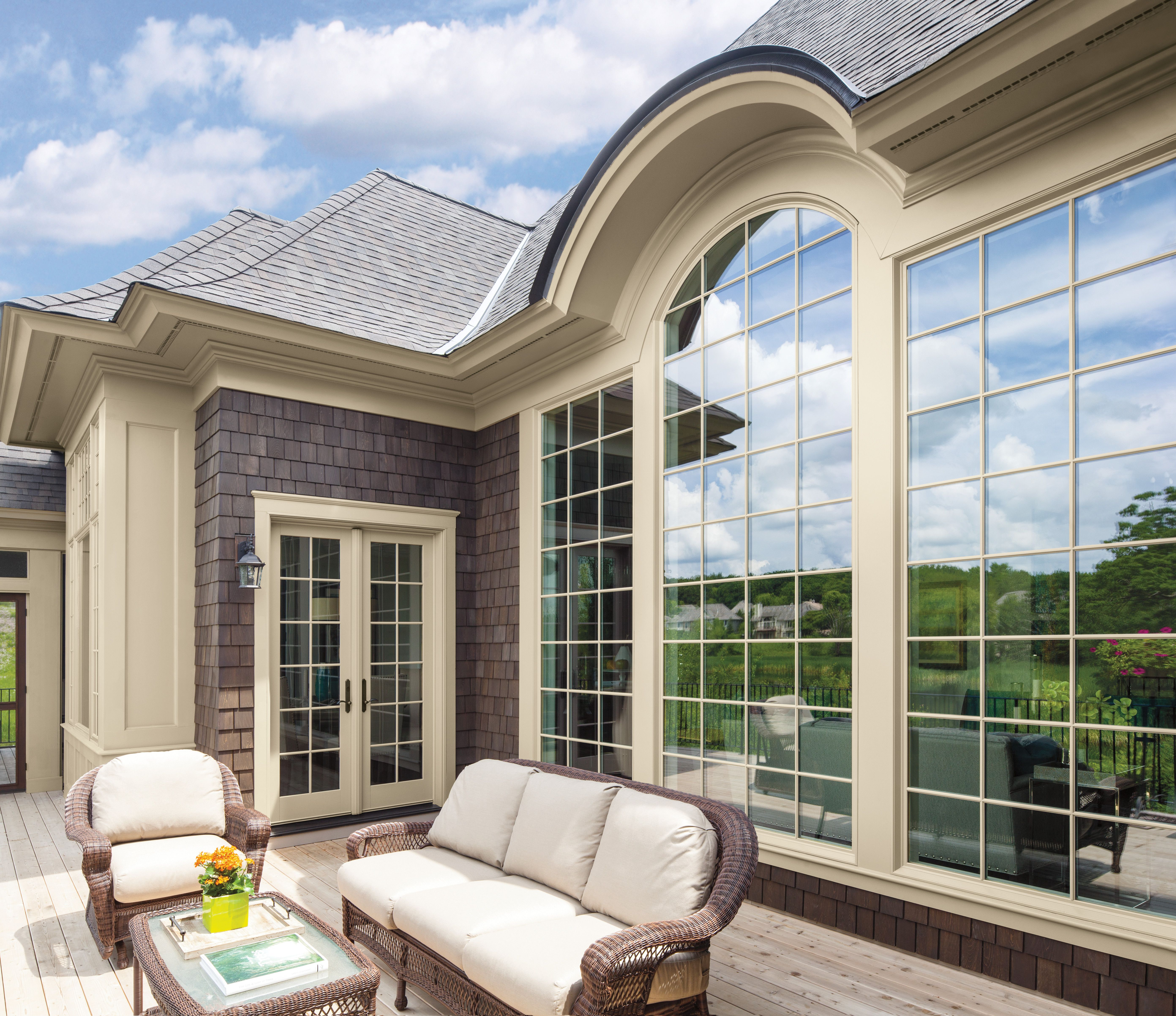 Hinged French doors from Renewal by Andersen provide easy access