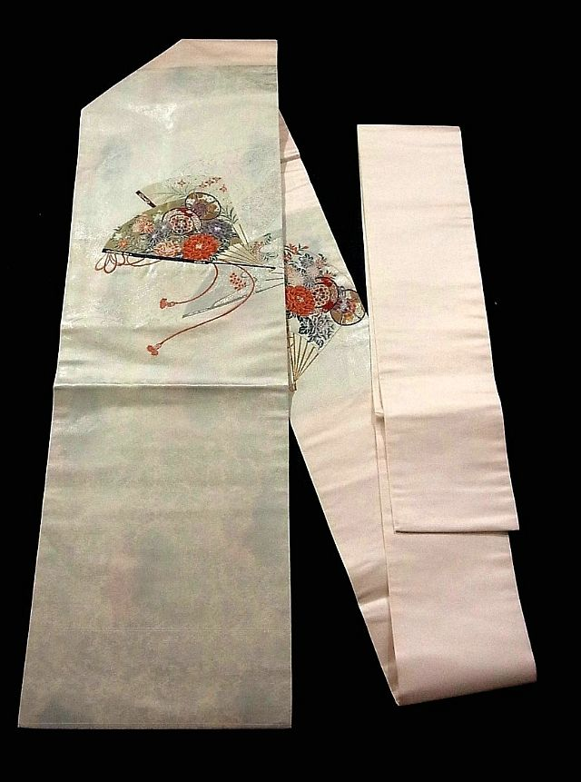 This is a Nagoya obi with graceful fan motifs, which are woven. It has botan (peony), kiku (chrysanthemum) and 'tsuzumi' (Japanese hand drum) design on the fan.