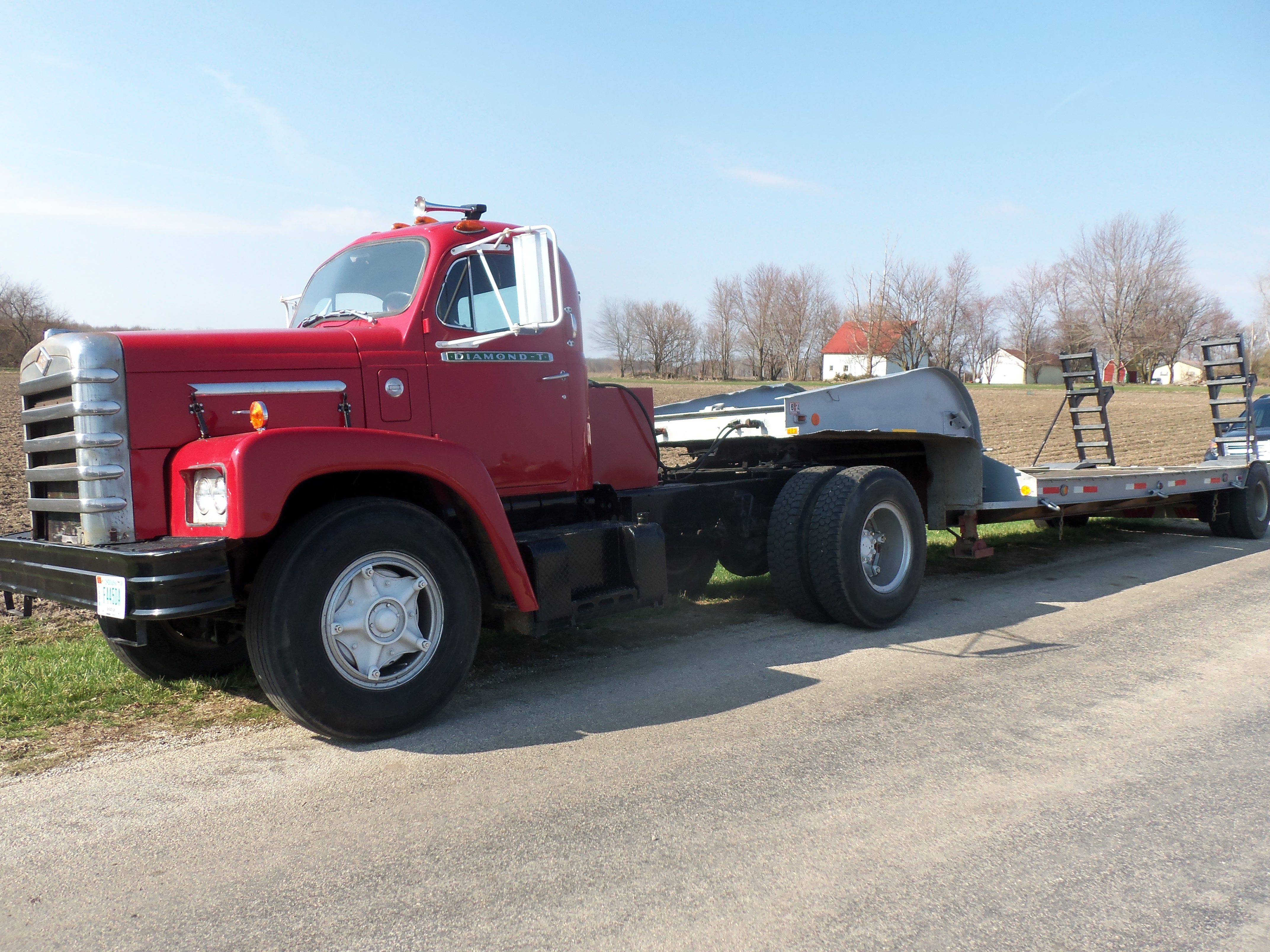 Red diamond t with lowboy trailer