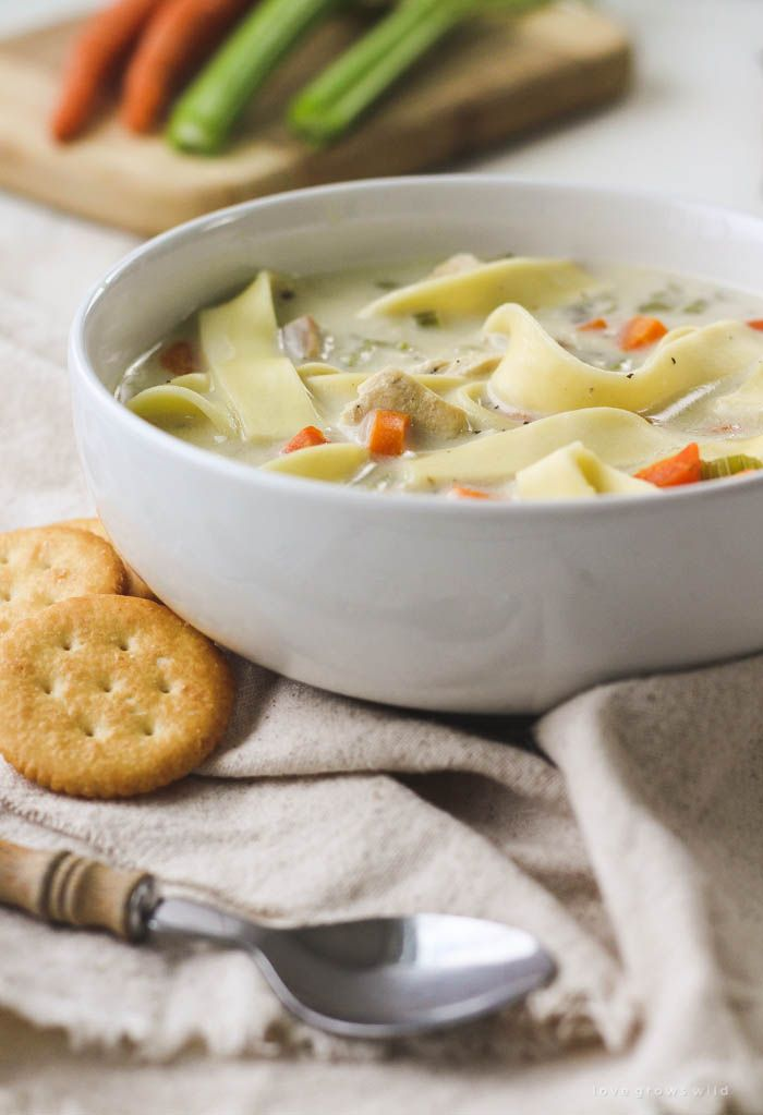 This homemade Creamy Chicken Noodle Soup is easy to make and so comforting! Get the recipe for this super creamy homemade soup at LoveGrowsWild.com