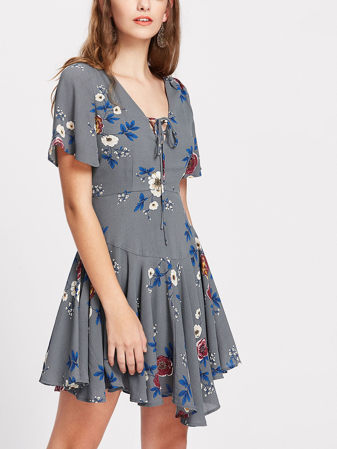 c9328dec181ae Shop Flower Print Lace Up Plunge Neck Paneled Flowy Dress online. SheIn  offers Flower Print Lace Up Plunge Neck Paneled Flowy Dress & more to fit  your ...