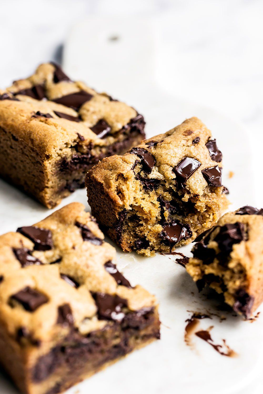 Super Thick And Chewy Peanut Butter Chocolate Chunk Cookie Bars Cookie Bar Recipes Peanut Butter Recipes Chocolate Peanut Butter