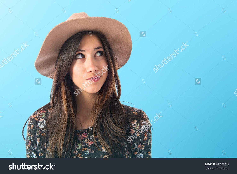 Stockphotocutewomanthinkingovercolorfulbackground