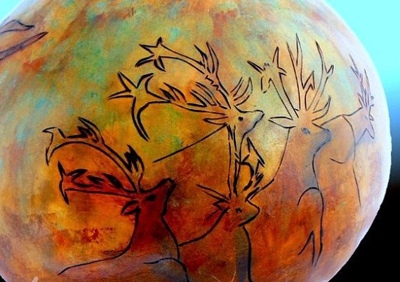 Cave Art Gourd Nine inches  in diameter by eight by Gourdacopia