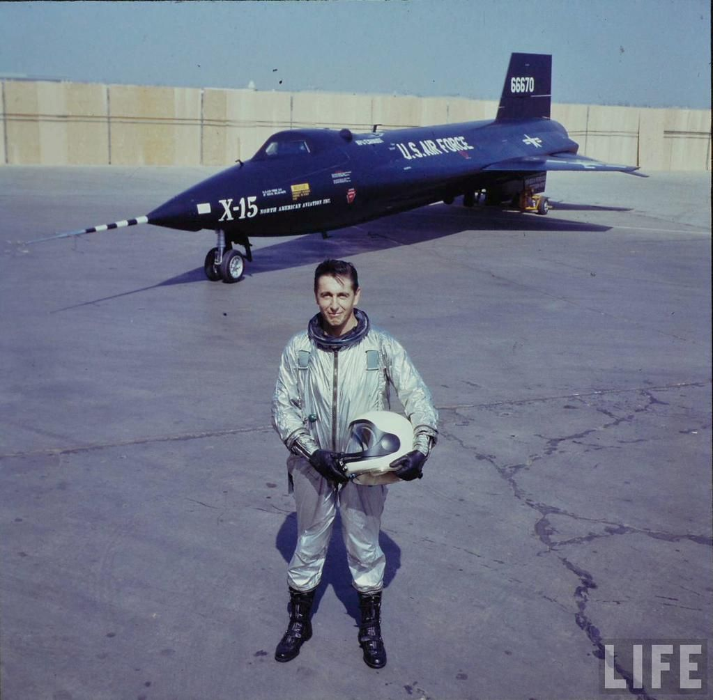 Scott Crossfield (first person to fly twice the speed of sound) beside an  X-15, by Allan Grant, 1960s