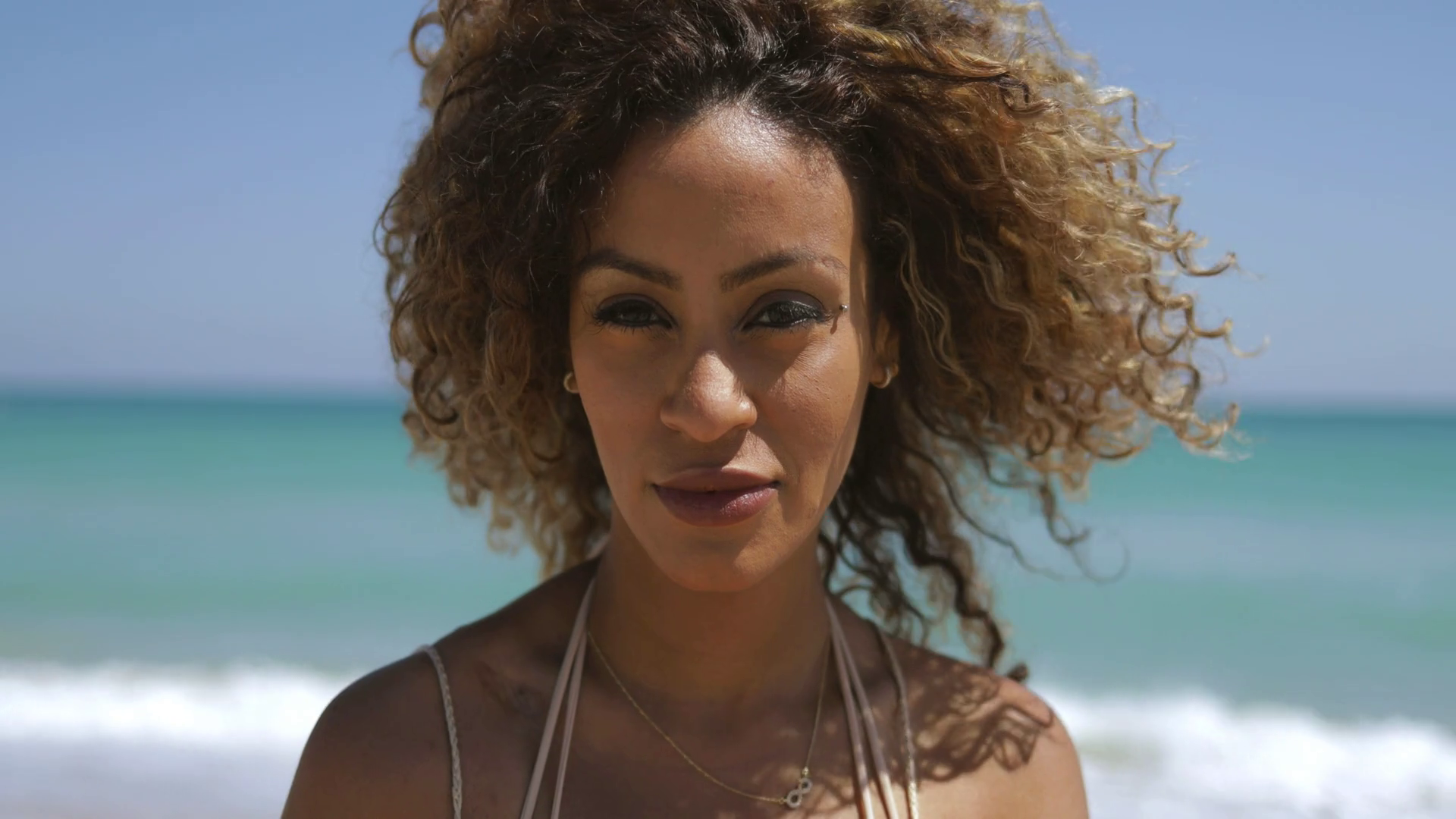 Portrait Of Wonderful Black Woman With Curly Hair Flying In Wind Enjoying Sunlight On Tropical Coastline And Smiling At Camera Stoc Regrow Hair Fall Hair Hair