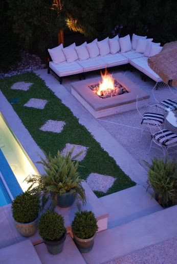 gravel area beside pool for a fire pit seating with an eating area nearby l shape couch and fire pit - L Shape Garden Decor