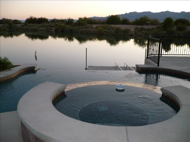 8 - sleeps 12-15 pool, on river, ? location, rate varies  in