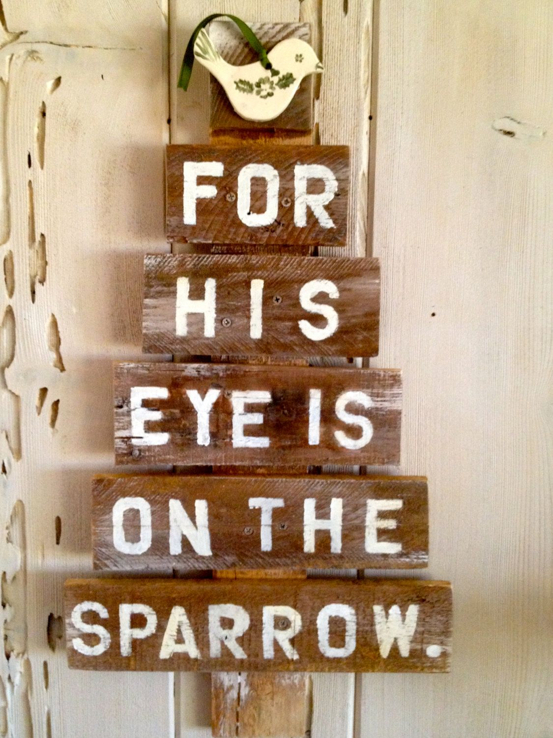 Ceramic Bird on Reclaimed  Pallet Tree . Saying For His Eye Is on The Sparrow. Wonderful witness to Gods watchful eye over us. by ABStudioWest on Etsy https://www.etsy.com/listing/211425777/ceramic-bird-on-reclaimed-pallet-tree