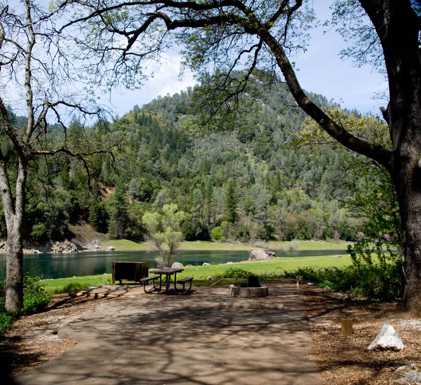 Camping Cabins National Forest Nm: Shaded Campsite With Lake And Mountains In The Background