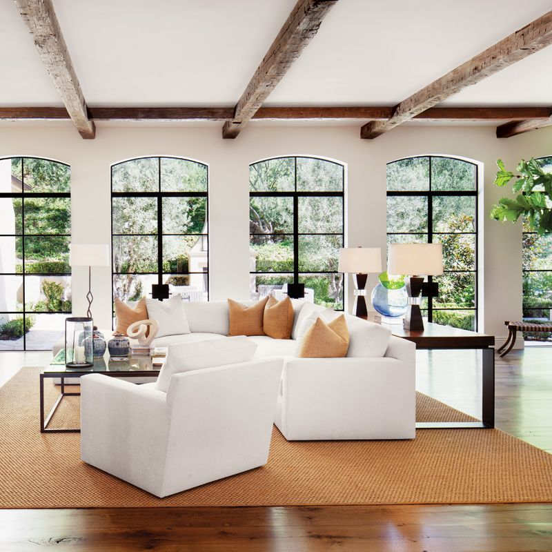 Photo of Country Cream Living Room with Antique Ceiling Beams | Luxe Interiors + Design