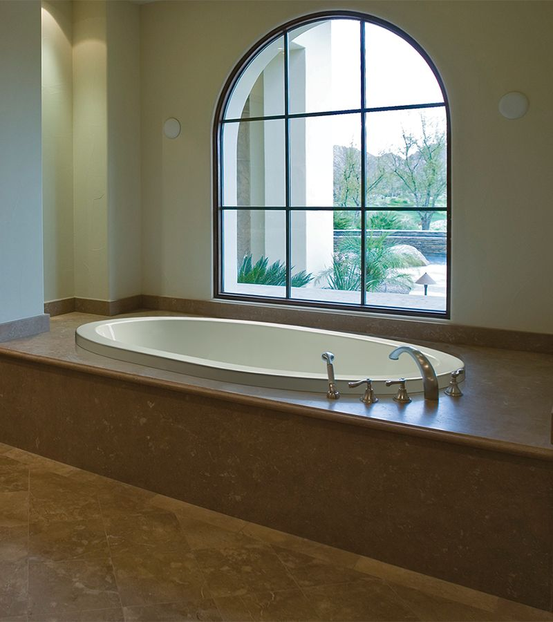 An oval drop-in tub with a textured bottom.   Master Bath Ideas ...