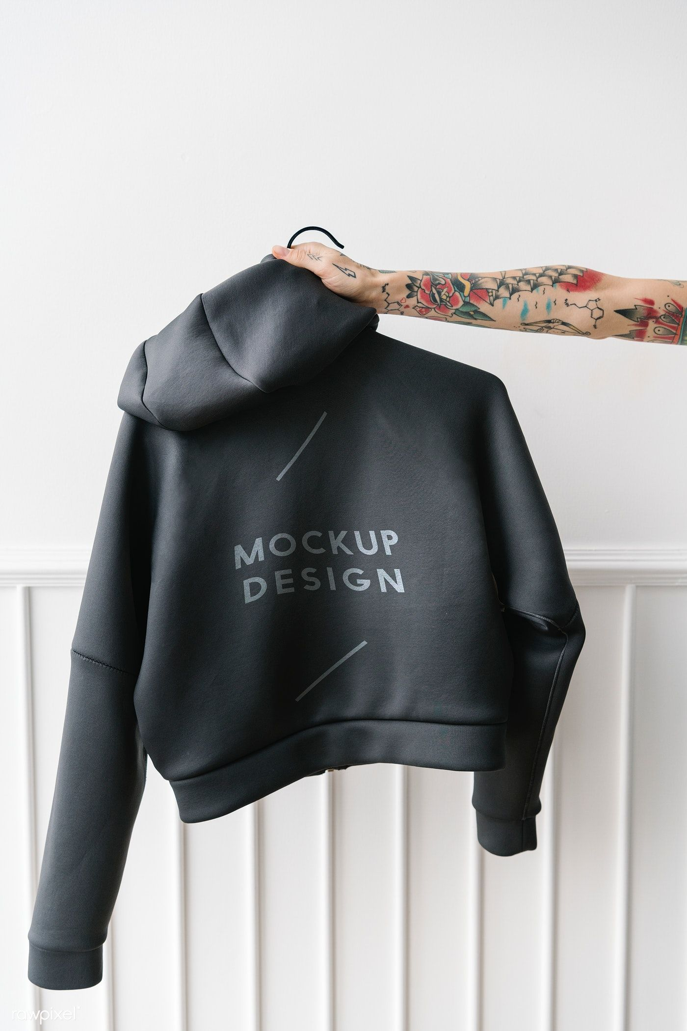Download Download Premium Psd Of Tattooed Woman Holding A Gray Hoodie Mockup 1215336 Hoodie Mockup Grey Hoodie Shirt Mockup