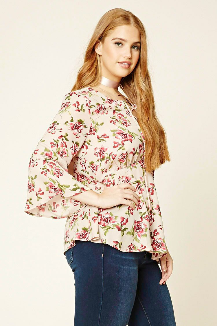 137034df012 Forever 21+ - A woven top featuring an allover floral print