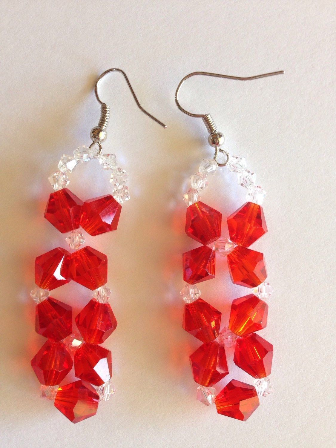 A personal favorite from my Etsy shop https://www.etsy.com/listing/232515103/red-swarovski-dangle-earrings