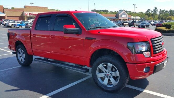 "my 2012 ford f150 fx2 race red leveled on 33"" tires. 