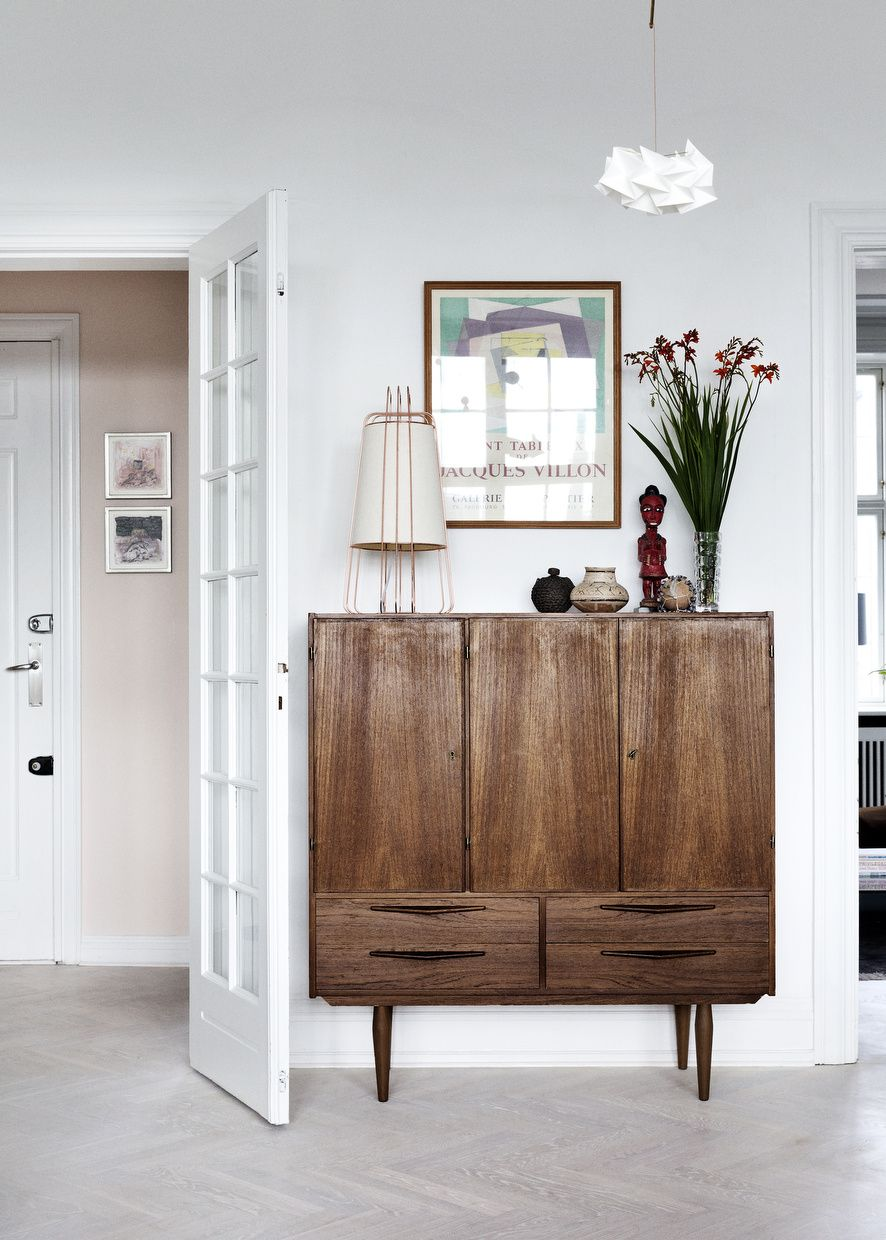 Home with character in Copenhagen - love the combination of pastel walls with the deep colors of the furniture and accessories