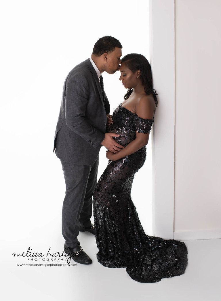 0d8dfc2654858 Melissa Hartigan Photography CT Newborn and Maternity Photographer  maternity pose mom wears a long black sequined maternity dress posed with  husband kissing ...