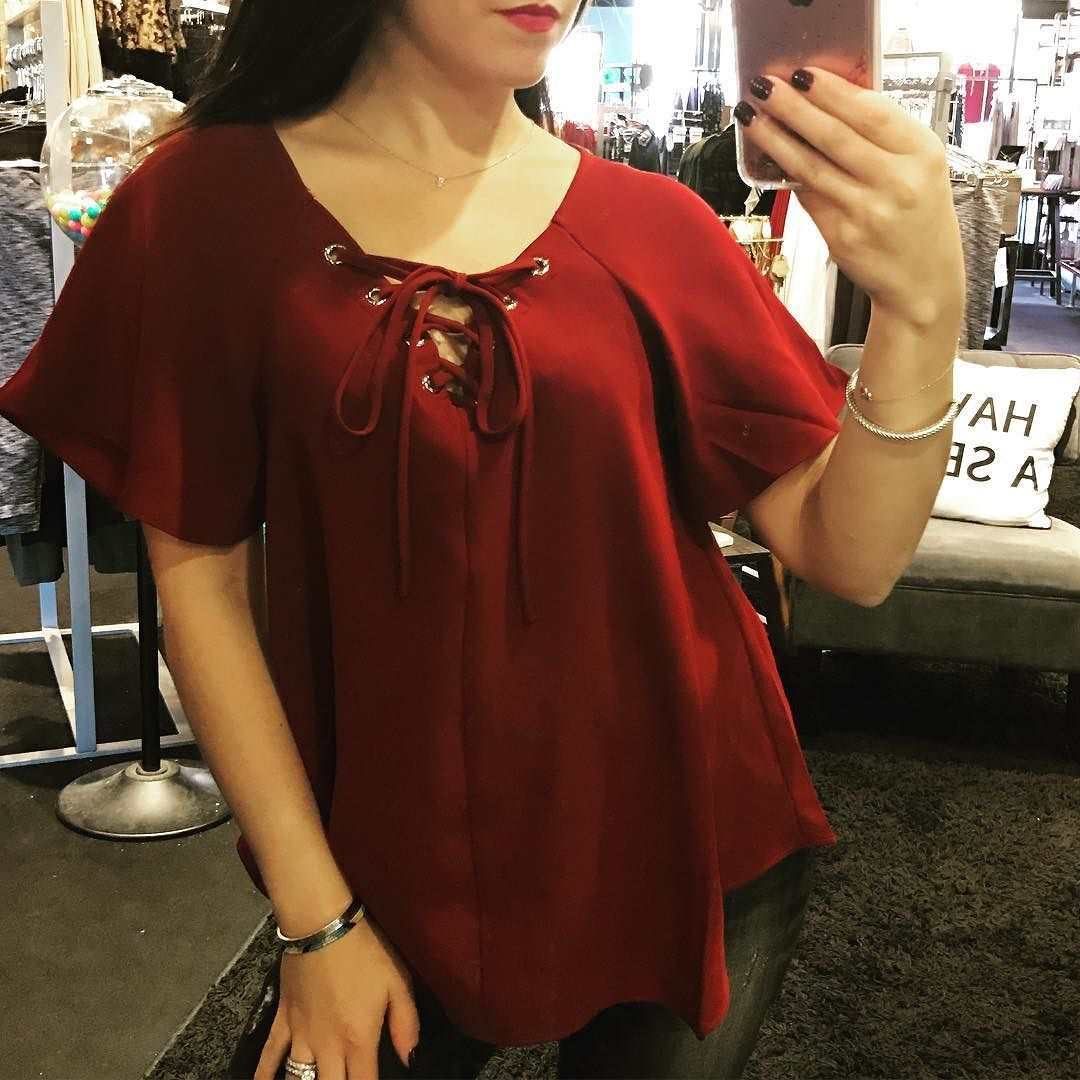 """You can't help but fall in love with this top  """"Carrie"""" lace up top ($59)  Gotta  FREE SHIPPING! Call 440.893.9279 or email sales@sanitystyle.com to order or shop instore!  #sanitystyle #sanitychagrinfalls #shoplocal #chagrinfalls #shopchagrinfalls #boutique #freeshipping #cleveland #clevelandfashion #clevelandstyle #style #shop #cle #thisiscle #love #selloninsta #instasale #fashionpost #beautiful #picoftheday #shopping #shopaholic #fall #fallfashion  #retailtherapy"""