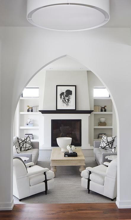 Walk Through A Moorish Style Doorway Into A Black And White Sunken Living Room Mediterranean Living Rooms Sunken Living Room Modern Mediterranean Homes