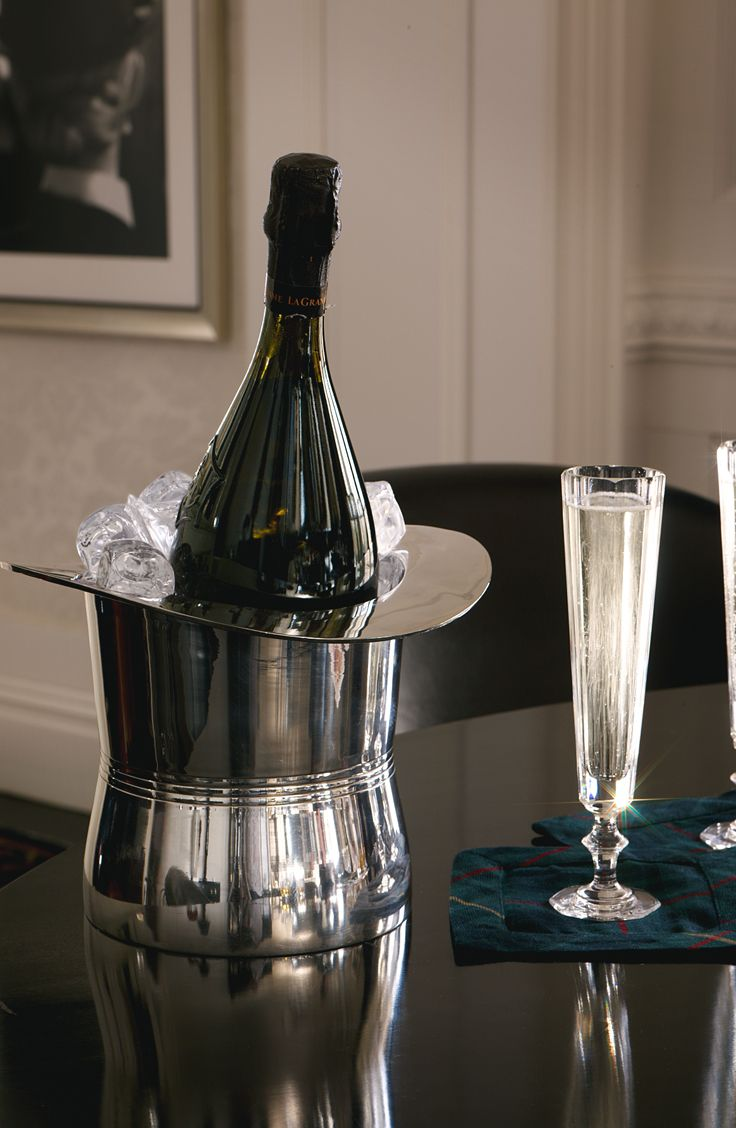 Ralph Lauren Home's top hat ice bucket and champagne flutes make for a festive toast