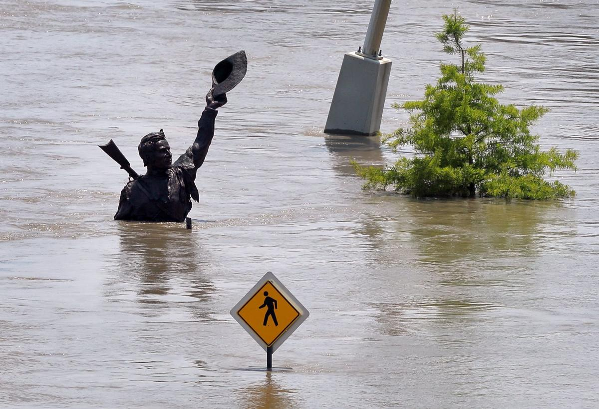 Levee fails, crests coming as flooding woes continue