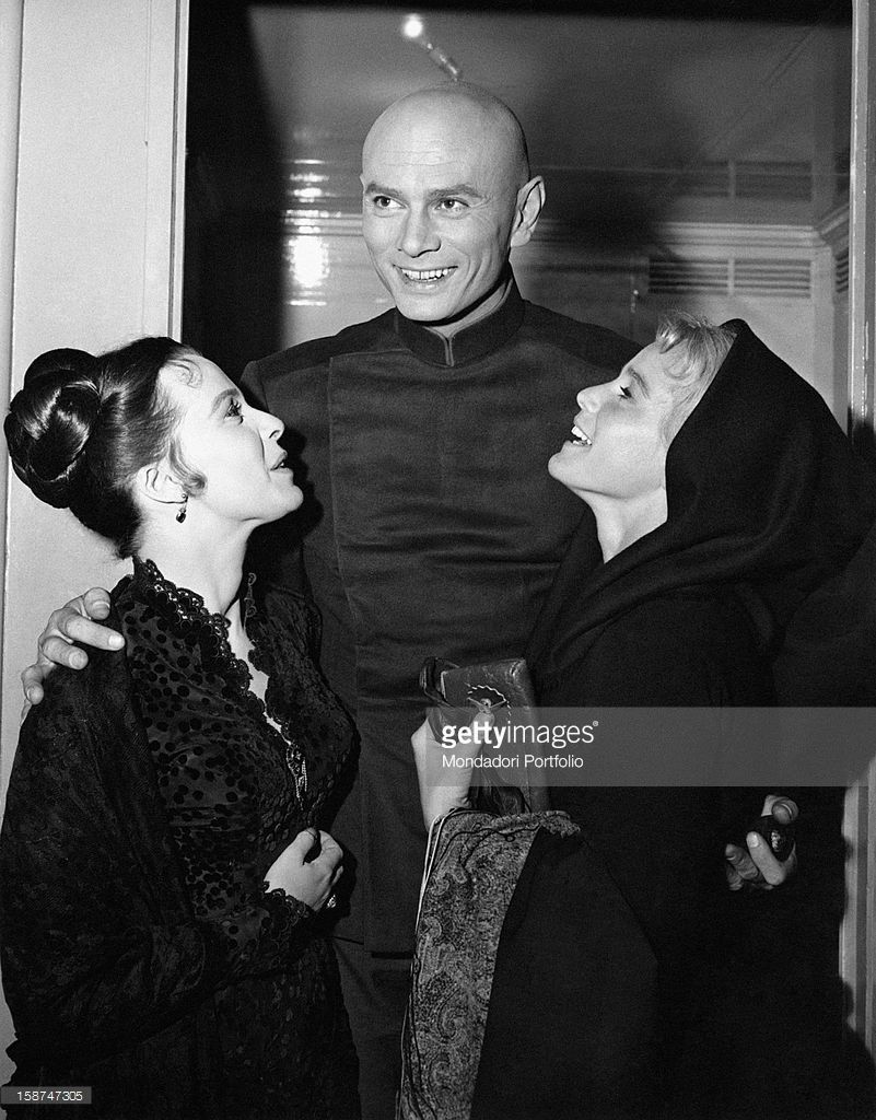 American actor Yul Brynner (Yuliy Borisovich Bryner) is with Austrian actress Maria Schell and British actress Claire Bloom on the film set of The Brothers Karamazov. Hollywood, USA, 1958