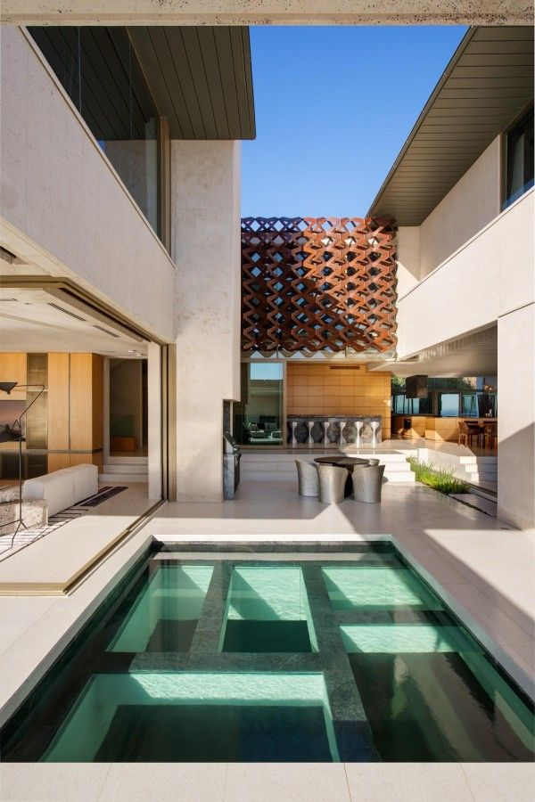 In a space this beautiful, any architect would strive to maximize the experience of outdoor spaces. A sparkling pool and expansive outdoor terrace is inviting during warmer months, while a winter lounge off the kitchen offers a relaxing space for entertaining when temperatures drop.