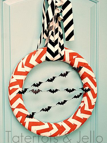 Use baker's twine to string tiny, paper bats through your wreath to add a subtle Halloween touch.