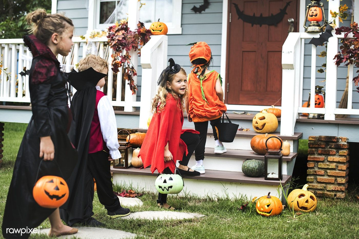 Download premium photo of Little kids trick or treating