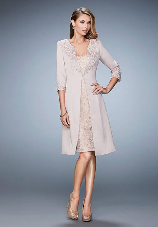 3ba726283b2 Charming knee length dress with embroidered lace and jewel overlay. This  dress comes with a matching 3 4 sleeve
