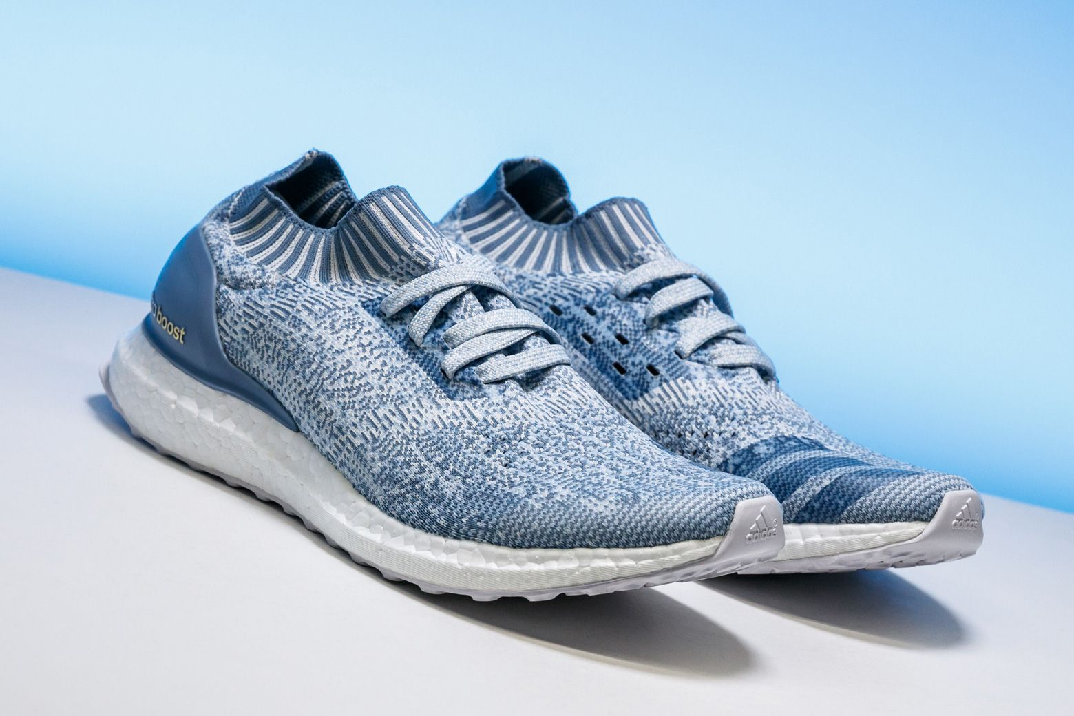 38e4b9ab80ff8 This cageless women s version of the adidas Ultra Boost features an  eye-catching light blue colorway.