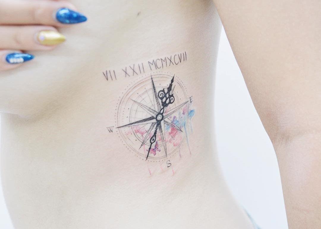 Small girly compass tattoo