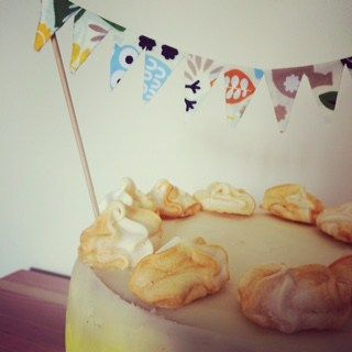 Lemon Ombre cake with meringue kisses and hand made baby bunting