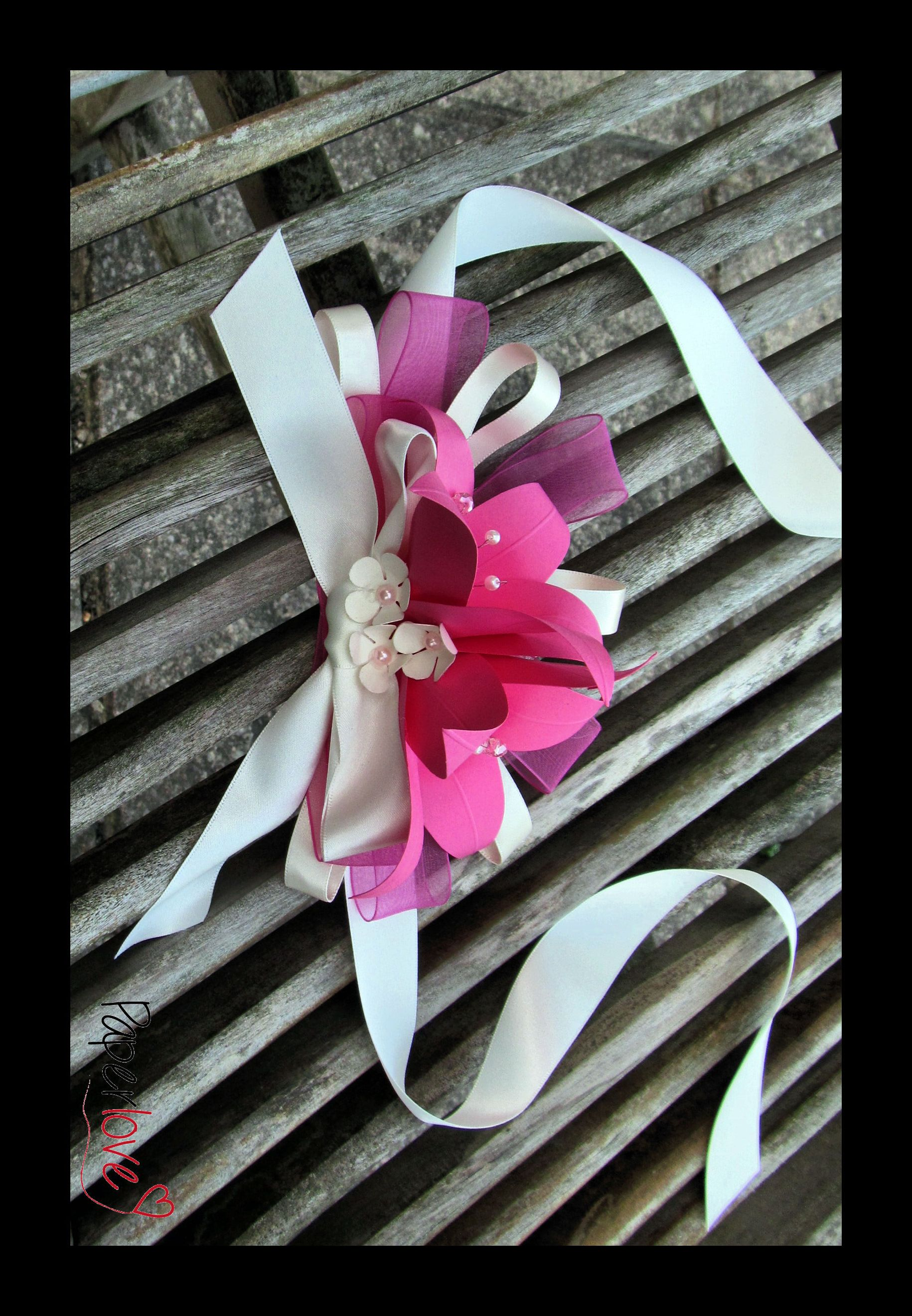 hot pink lily wrist corsage https://www.facebook.com/flowers.eb