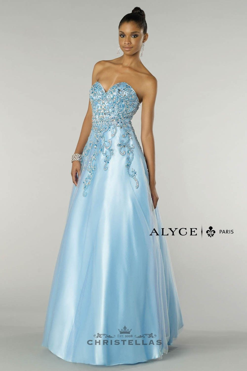 A classic Cinderella-inspired ball gown featuring a sweetheart ...