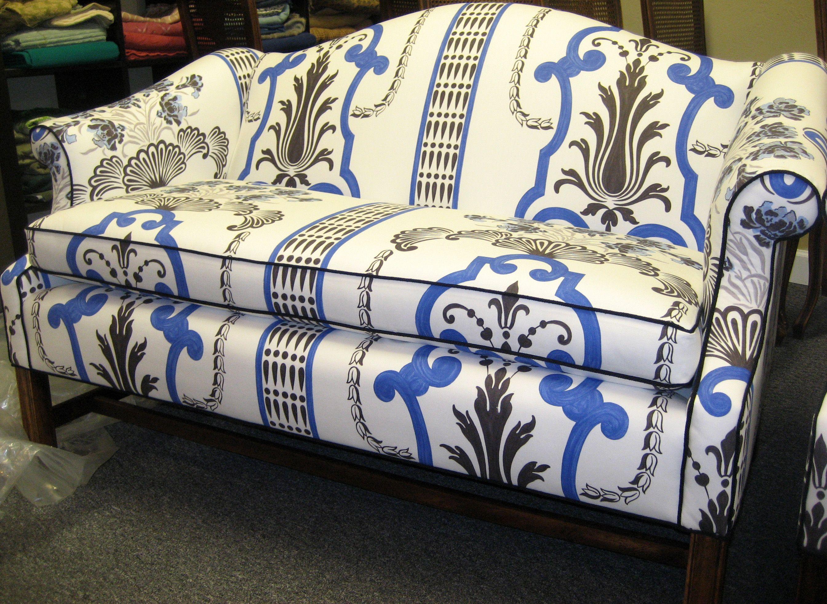Reupholstered camel back sofa