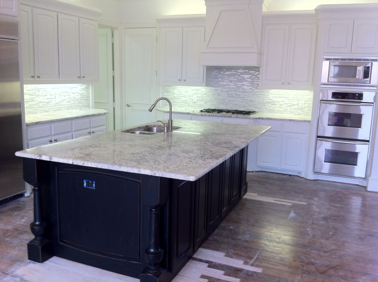 Cultured marble kitchen countertops - Carrera Marble Countertop With Black Cabinets Carrera Marble Glass Tile Backsplash White Kitchen