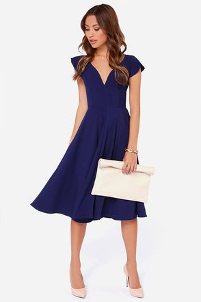 """LuLu*s Exclusive! This medium-weight woven poly dress has a fitted bodice with a curvy V neckline and short, fluttery cape sleeves. A full midi-length skirt, hidden back zipper. Front of bodice is lined. Model is 5'7"""" and is wearing a size small. 85% Polyester, 12% Viscose, 3% Spandex. Hand Wash Cold. Made with ..."""