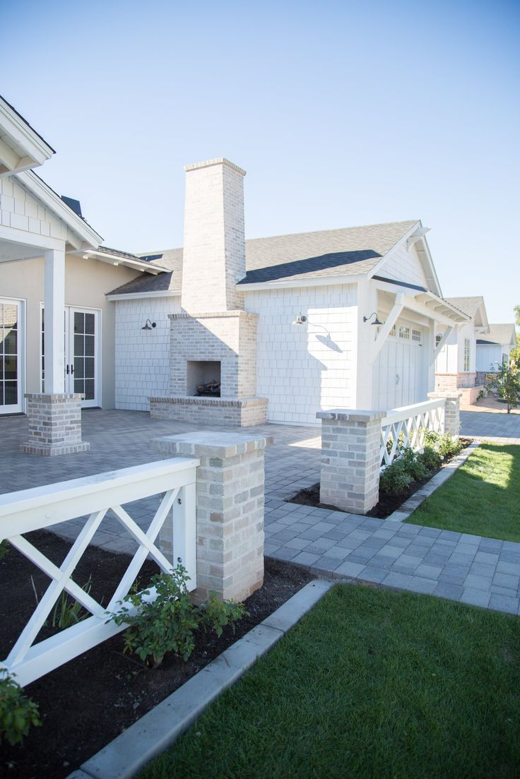 front patio with brick fireplace by rafterhouse dream house