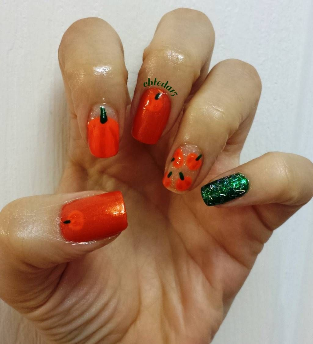 Thumb & Middle nails with dark orange with baby pumpkin. Pointer ...