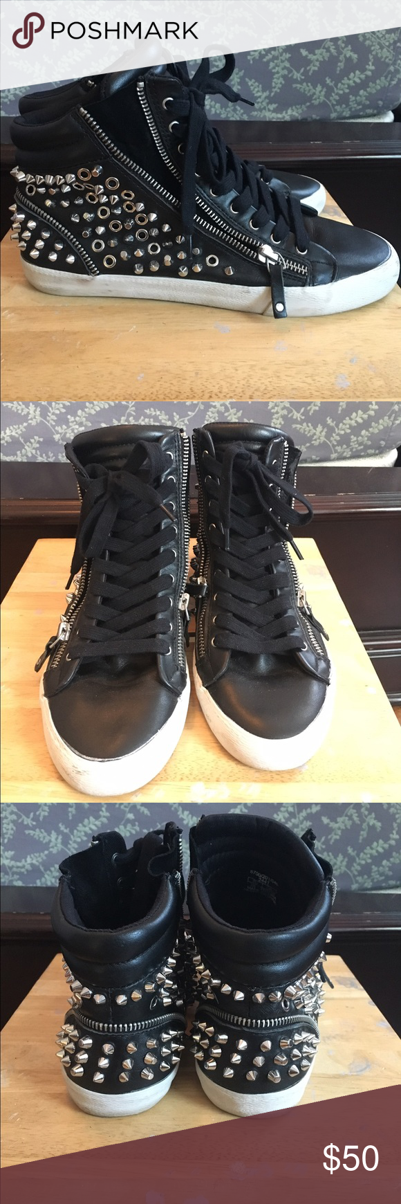 ZARA Black Genuine Leather Hi-Top Studded Sneakers Black leather sneakers. Silver studded design. All studs intact. Zipper on each side of each shoe, can adjust. White soles. Worn only a few times. ZARA 38 Zara Shoes Sneakers