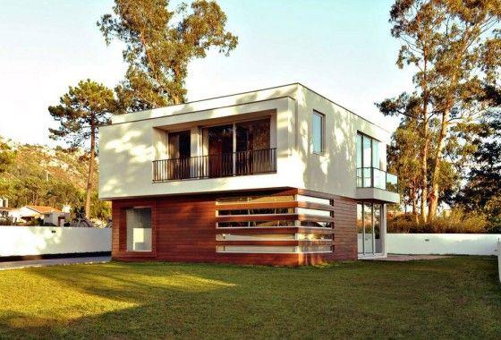 diseo de casa cuadrada pequea de dos pisos construida en hormign y con hermosa fachada que emplea elementos