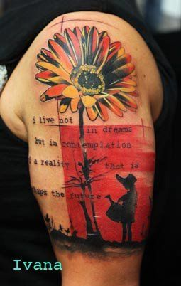 Upper arm, flower tattoo.
