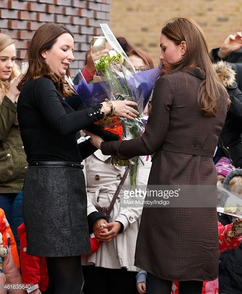 Catherine Duchess of Cambridge hands Rebecca Deacon flowers she received from local children as she attends an event hosted by The Fostering Network to celebrate the work of foster carers in...