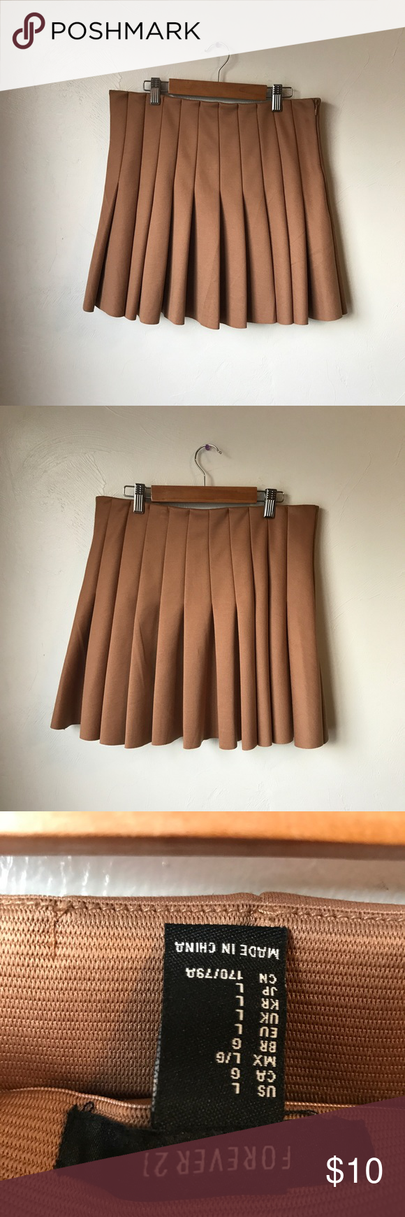 Forever 21 schoolgirl pleated miniskirt beige sz L Love this skirt I'm so sad it doesn't fit☹️ its size large would fit prob a 8/10, it's pretty thick material and feels quality even tho it's forever 21, it has an elastic waist and super comfy Forever 21 Skirts Mini