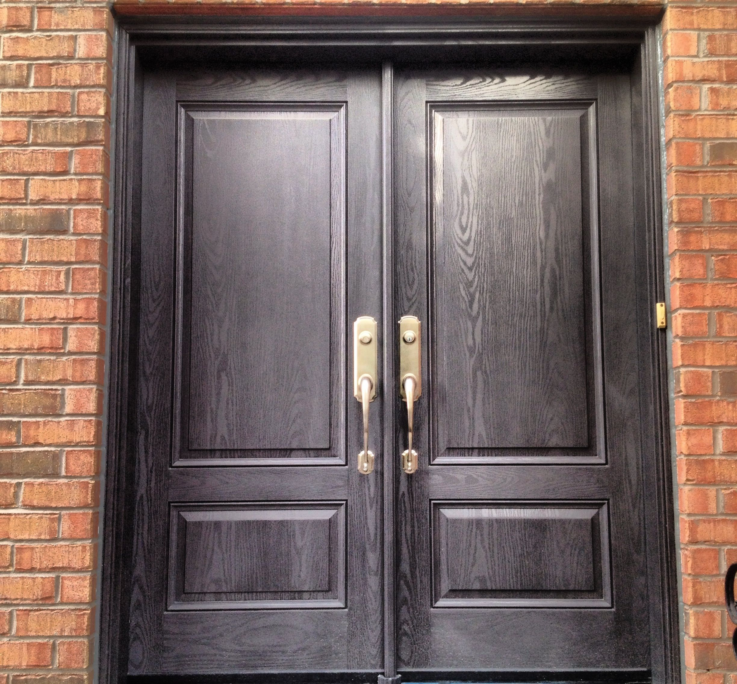 2 panel woodgrain fiberglass double door in charcoal stain for Fiberglass entrance doors