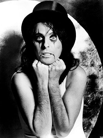 Alice Cooper Wearing A Top Hat And Makeup Early 1970s From Alice